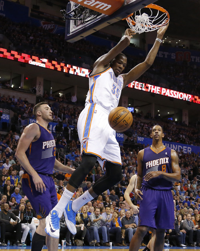 Oklahoma City Thunder small forward Kevin Durant (35) dunks the ball between Phoenix Suns power forward Miles Plumlee (22) and Channing Frye (8) during an NBA basketball game between the Oklahoma City Thunder and the Phoenix Suns at Chesapeake Energy Arena in Oklahoma City, Sunday, Nov. 3, 2013. Oklahoma City won 103-96. Photo by Bryan Terry, The Oklahoman