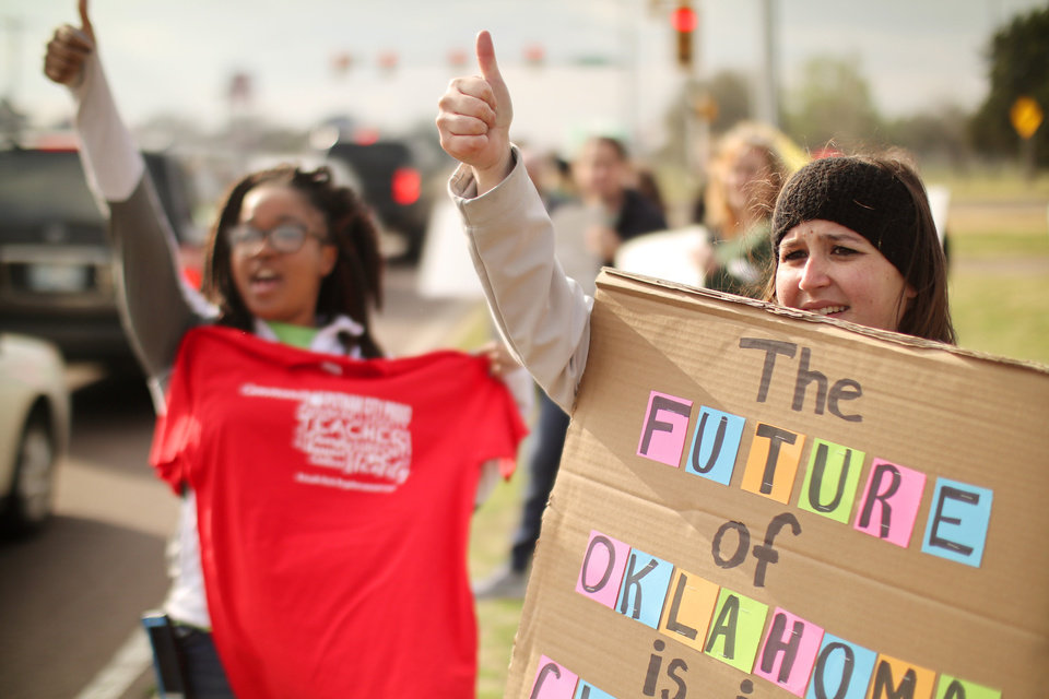 Photo - Laura Brothers, Northridge Elementary, left, and Jordann (JORDANN) Hardin, Northdridge Elementary, hold signs and wave as teachers rallied at N.W. Expressway and North Meridian during rush hour traffic in Oklahoma City, Thursday, March 29, 2018. Photo by Doug Hoke, The Oklahoman