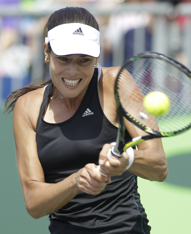 Photo - Ana Ivanovic, of Serbia, hits a return to Flavia Pennetta, of Italy, during a match at the Sony Open tennis tournament, Saturday, March 22, 2014, in Key Biscayne, Fla. (AP Photo/Luis M. Alvarez)