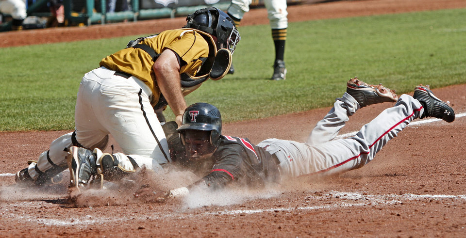 Photo - COLLEGE BASEBALL / BIG 12 BASEBALL TOURNAMENT  / TEXAS TECH UNIVERSITY OF MISSOURI: Missouri's Brett Nicholas tags out Texas Tech's Jamodrick McGruder at home in the fifth inning of a Big 12 baseball championship tournament game between Missouri and Texas Tech at the AT&T Bricktown Ballpark in Oklahoma City, Saturday, May 29, 2010.  Photo by Bryan Terry, The Oklahoman  ORG XMIT: KOD