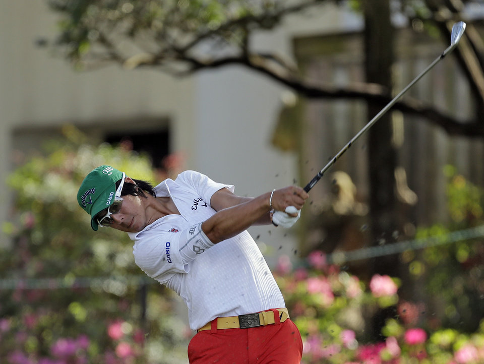 Photo - Ryo Ishikawa, of Japan, follows through on a shot on the 17th hole during the first round of the Arnold Palmer Invitational golf tournament at Bay Hill on Thursday, March 20, 2014, in Orlando, Fla. (AP Photo/Chris O'Meara)