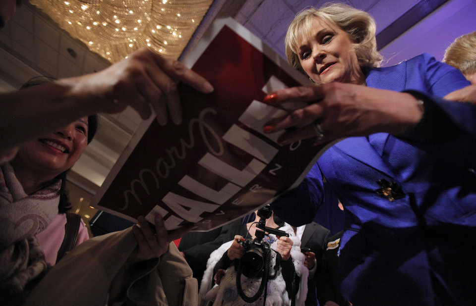 Photo - Governor elect Mary Fallin signs a campaign sign for a supporter after her win over Jari Askins at the republican Watch Party at the Marriott on Tuesday, Nov. 2, 2010, in Oklahoma City, Okla.   Photo by Chris Landsberger, The Oklahoman