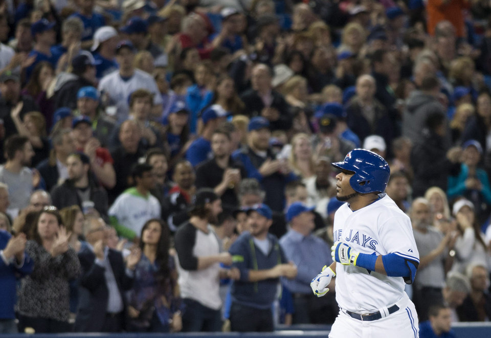 Photo - Toronto Blue Jays' Edwin Encarnacion gets a standing ovation as he rounds the bases following a solo home run in the second inning of a baseball game against the Philadelphia Phillies in Toronto on Thursday, May 8, 2014. (AP Photo/The Canadian Press, Darren Calabrese)