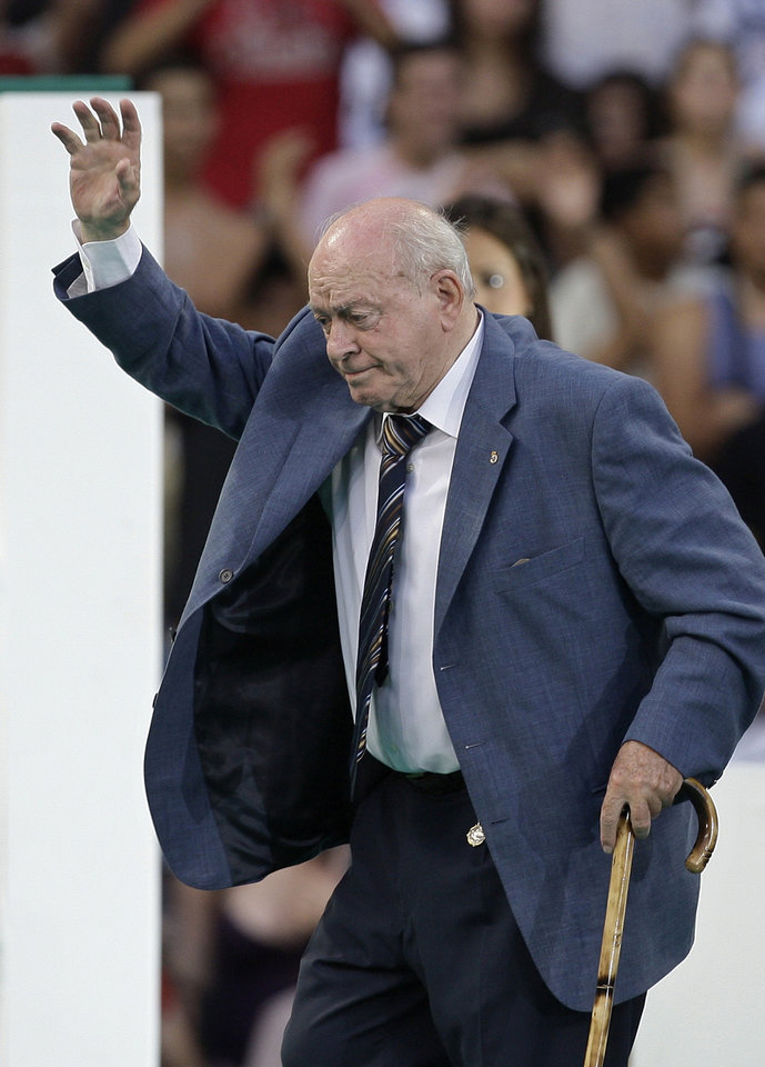 Photo - FILE - In this July 6, 2009 file photo, former Real Madrid soccer star and the club's honorary president Alfredo di Stefano of Argentina waves before the official presentation of Portuguese soccer player Cristiano Ronaldo at the Santiago Bernabeu stadium in Madrid, Spain. Real Madrid on Monday July 7, 2014 says Alfredo Di Stefano has died at age 88. Di Stefano helped Madrid win five straight European Champions Cups, and was voted European player of the year in 1957 and '59. He was 88 years old.(AP Photo/Paul White, File)