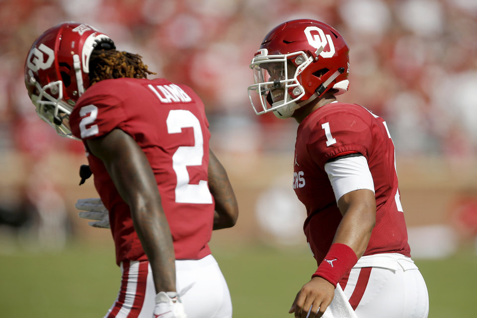 Photo - Oklahoma's Jalen Hurts (1) celebrates with Oklahoma's CeeDee Lamb (2) during a college football game between the University of Oklahoma Sooners (OU) and Texas Tech University at Gaylord Family-Oklahoma Memorial Stadium in Norman, Okla., Saturday, Sept. 28, 2019. Oklahoma won 55-16. [Bryan Terry/The Oklahoman]