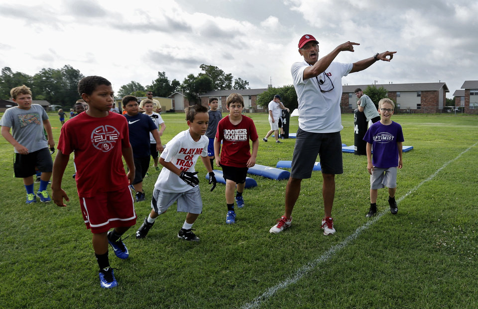 Photo - University of Oklahoma's (OU) co-offensive coordinator Jay Norvell hosts his annual youth camp at Whittier Middle School on Tuesday, June 17, 2014 in Norman, Okla.  Photo by Steve Sisney, The Oklahoman