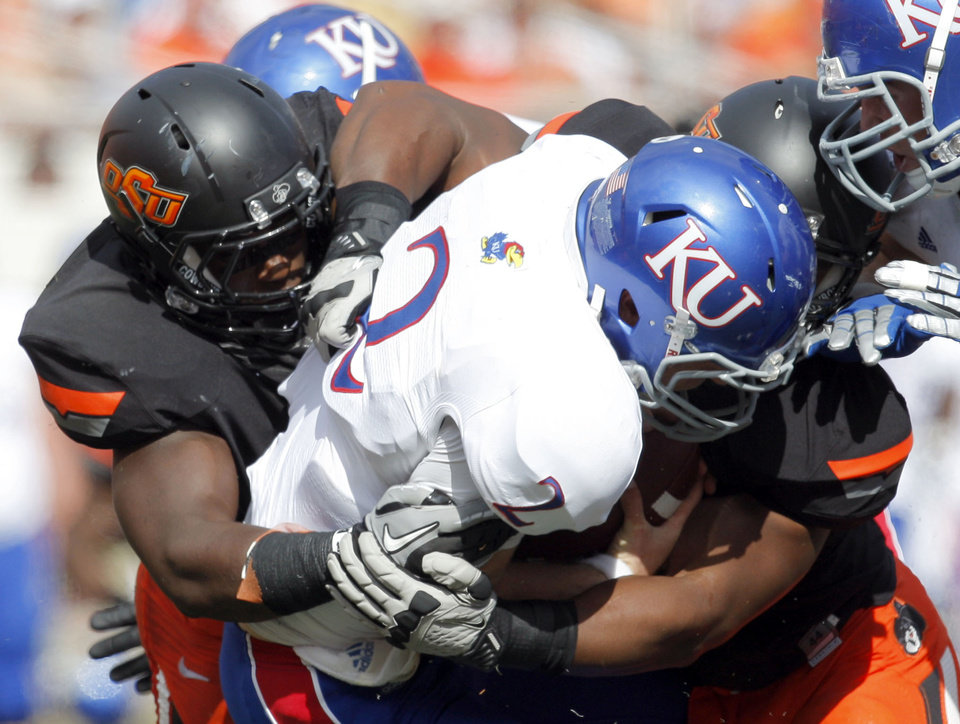 Photo - Oklahoma State's Shaun Lewis (11), left, and Tyler Johnson (40) sack Kansas' Jordan Webb (2) during the first half of the college football game between the Oklahoma State University Cowboys (OSU) and the University of Kansas Jayhawks (KU) at Boone Pickens Stadium in Stillwater, Okla., Saturday, Oct. 8, 2011. Photo by Sarah Phipps, The Oklahoman
