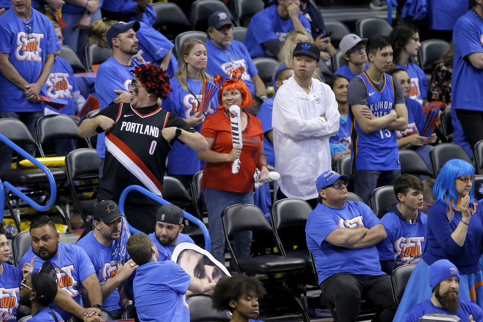 Photo - Portland fans celebrate during Game 4 in the first round of the NBA playoffs between the Portland Trail Blazers and the Oklahoma City Thunder at Chesapeake Energy Arena in Oklahoma City, Sunday, April 21, 2019. Portland won 11-98.  Photo by Bryan Terry, The Oklahoman