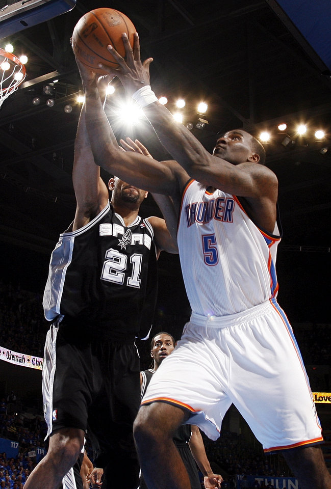 Photo - Oklahoma City's Kendrick Perkins (5) grabs a rebound next to San Antonio's Tim Duncan (21) during Game 3 of the Western Conference Finals between the Oklahoma City Thunder and the San Antonio Spurs in the NBA playoffs at the Chesapeake Energy Arena in Oklahoma City, Thursday, May 31, 2012. Oklahoma City won, 102-82. Photo by Nate Billings, The Oklahoman