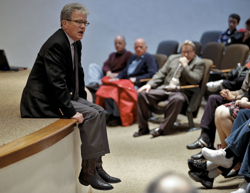 Photo - U.S. Sen. Tom Coburn talks Wednesday at his town hall meeting on the Metro Tech Springlake campus in Oklahoma City. Photos by Chris Landsberger, The Oklahoman