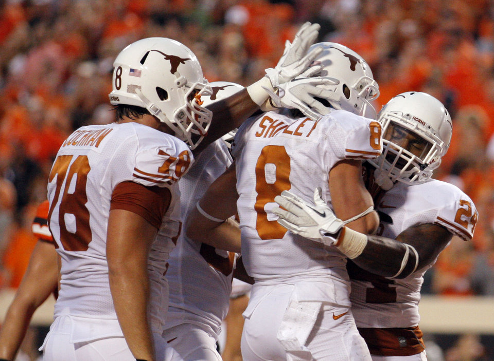 Photo - Texas celebrates a Texas' Jaxon Shipley (8) touchdown during a college football game between Oklahoma State University (OSU) and the University of Texas (UT) at Boone Pickens Stadium in Stillwater, Okla., Saturday, Sept. 29, 2012. Photo by Sarah Phipps, The Oklahoman