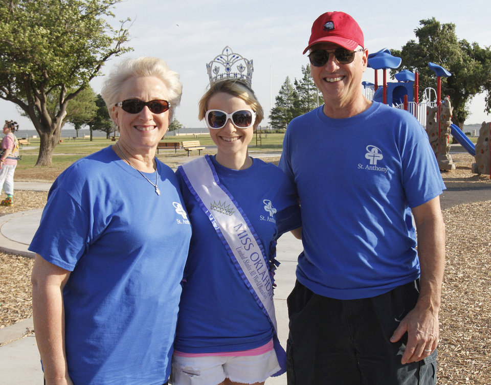 Photo - Diane Bofferding, Shaelynn Morefield, Miss Oklahoma United States, and Mike Bofferding participate in the NAMI (National Alliance on Mental Illness) walk at Stars and Stripes Park in Oklahoma City, OK, to raise money for mental illness causes, Saturday, May 19, 2012,  By Paul Hellstern, The Oklahoman
