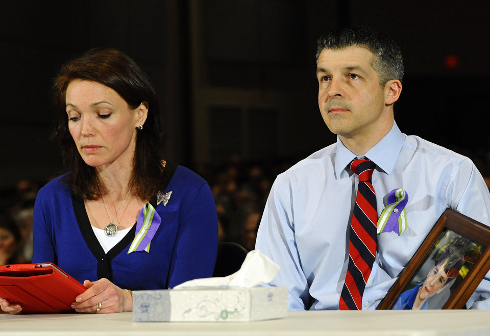 Photo - Nicole and Ian Hockley, parents of Sandy Hook School shooting victim Dylan, testify during a hearing of a legislative task force on gun violence and children's safety at Newtown High School in Newtown, Conn., Wednesday, Jan. 30, 2013. Connecticut lawmakers are in Newtown for the hearing, where those invited to give testimony include first responders and families with children enrolled at Sandy Hook Elementary. (AP Photo/Jessica Hill)