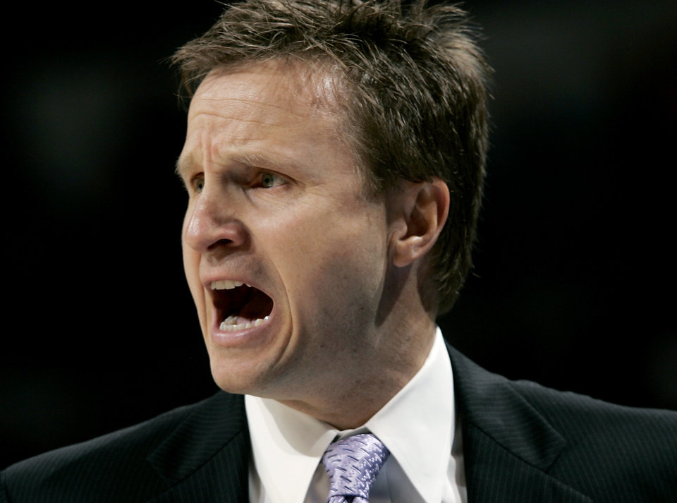 Photo - Oklahoma City's Head Coach Scott Brooks coaches the team as they play Philadelphia during the second half of their NBA basketball game at the Ford Center in Oklahoma City on Tuesday, Dec. 2, 2009. The Thunder beat the 76ers 117 to 106. By John Clanton, The Oklahoman