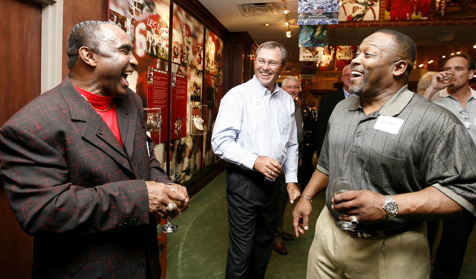 Photo - From left, Johnny Rodgers, of Nebraska, Leon Crosswhite, of OU, and Greg Pruitt of OU talk in Norman, Okla., Friday, October 31, 2008, during a reunion for the 1971 Game of the Century between the University of Oklahoma and Nebraska. BY BRYAN TERRY, THE OKLAHOMAN ORG XMIT: KOD