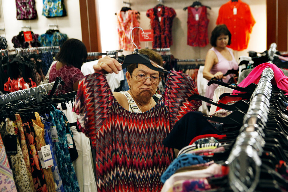 FILE - In this Friday, July 27, 2012, file photo, Teresa Chavez shops at JC Penney's in the Southaven Towne Center Mall in Southaven, Miss. On Thursday, Feb. 28, 2013, a day after J.C. Penney reported a much wider-than-expected loss, the retailer's stock is plummeting. (AP Photo/The Commercial Appeal, Kyle Kurlick, File)