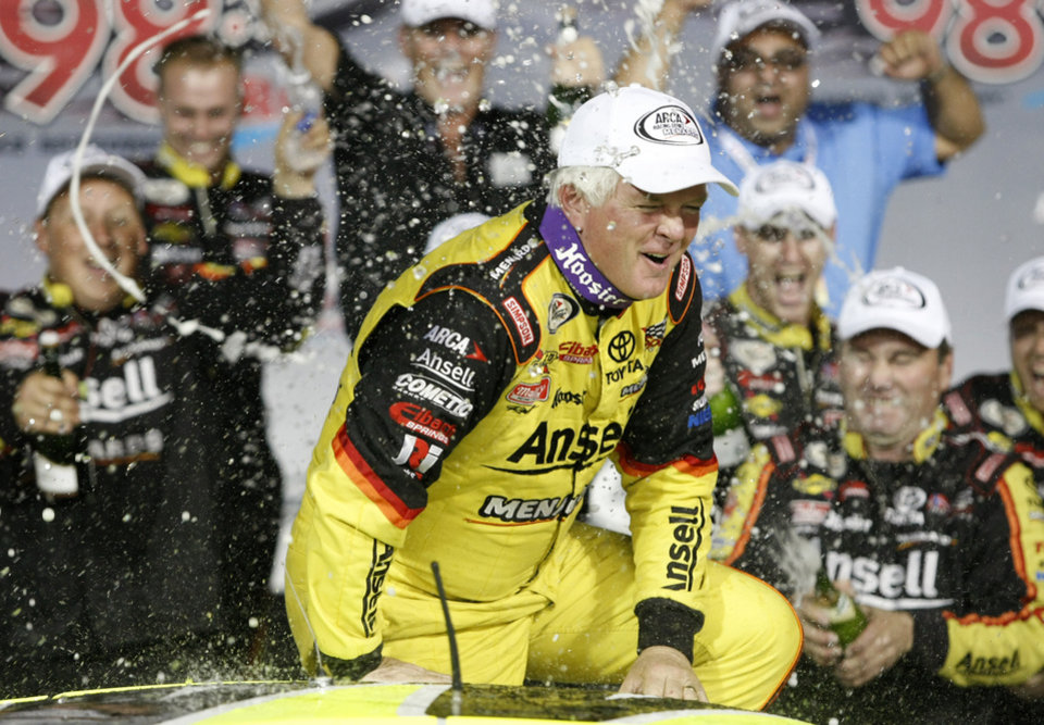 Photo - Frank Kimmel is sprayed by his crew after winning an ARCA racing series auto race and the ARCA points championship at Kansas Speedway in Kansas City, Kan., Friday, Oct. 4, 2013. (AP Photo/Colin E. Braley)