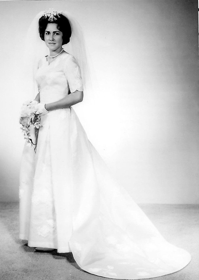 Photo - Aquanetta Peacock Pitzer was married on June 27, 1964. Money was tight during that time so she paid for the dress material herself, she said. Her grandmother made the dress and mother sewed the pearls and beads to the bodice, skirt and train.   - Photo provided by Aquanetta Pitz