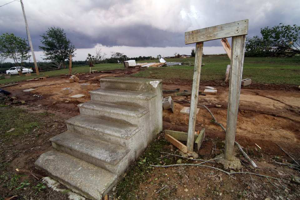 Photo - Concrete steps lead to remains of a tornado demolished mobile home in Preston,  Miss., Wednesday, April 27, 2011. The home and one next to it were blown about 100 feet away into a cow pasture. Three related women died at the site. (AP Photo/Rogelio V. Solis)