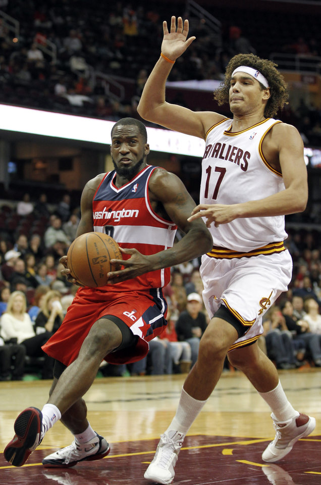 Photo -   Washington Wizards' Martell Webster (9) drives past Cleveland Cavaliers' Anderson Varejao (17) during the first quarter of an NBA preseason basketball game Saturday, Oct. 13, 2012, in Cleveland. (AP Photo/Tony Dejak)