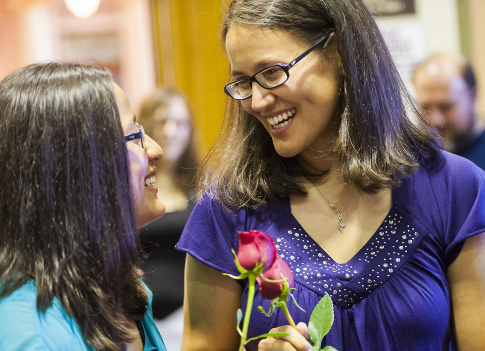 Photo - Jessie Finau, left and Stephanie Martinez talk after receiving their marriage license at the Pueblo County Courthouse, in Pueblo, Colo., Friday, July 11, 2014. Technically, their state still does not recognize gay marriages. But that hasn't stopped hundreds of gay Coloradans from getting marriage licenses from two county clerks who argue they still have the legal right to provide them to loving couples. (AP Photo/The Colorado Springs Gazette, Julia Moss)