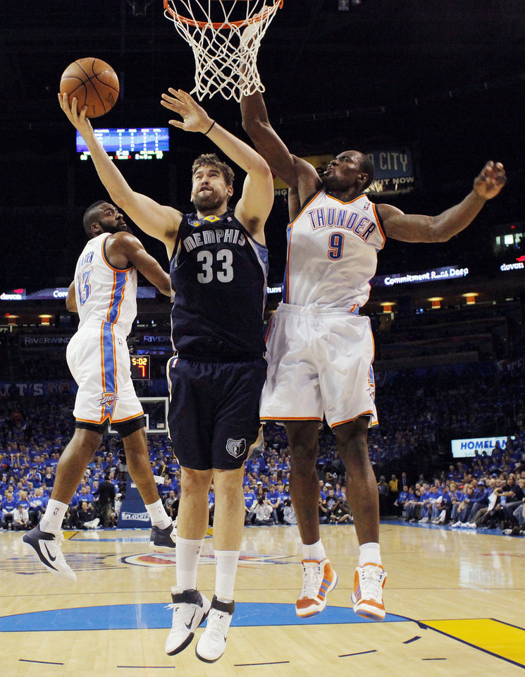 Photo - Marc Gasol (33) of Memphis takes a shot between James Harden (13) and Serge Ibaka (9) of Oklahoma City in the second half during game one of the Western Conference semifinals between the Memphis Grizzlies and the Oklahoma City Thunder in the NBA basketball playoffs at Oklahoma City Arena in Oklahoma City, Sunday, May 1, 2011. Memphis won, 114-101. Photo by Nate Billings, The Oklahoman