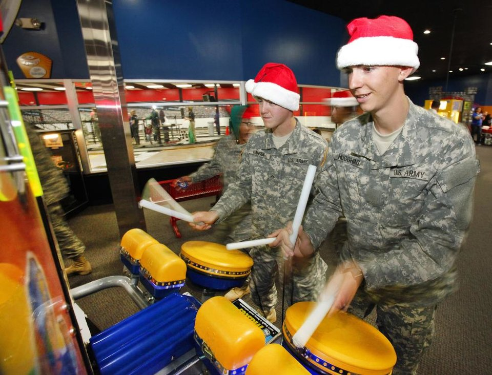 New recruit Pvt2 Cory Hansen and Pvt Taylor Hugghins play a drum games during a lunch stop at Gatti Town during Soldiers Day Out, Friday, December 21, 2012. Edmond/North OKC Blue Star Mothers will be taking the soldiers who can\'t go home for Christmas around the metro for a day of fun. Photo By David McDaniel/The Oklahoman