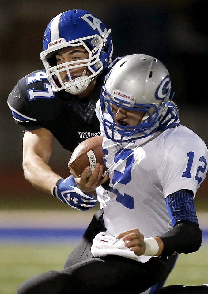 Photo -                    Deer Creek's Blake Landon, top, brings down Guthrie's Reed Roberts during a 2013 game. Landon led the Antlers in tackles last season.                                        Photo by Bryan Terry, The Oklahoman