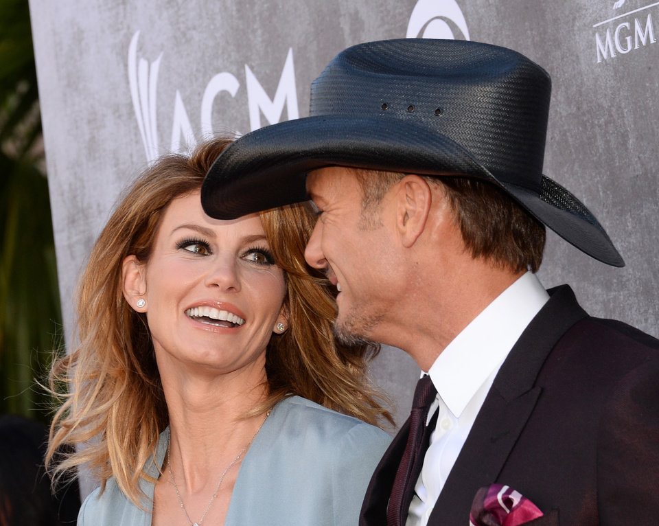 Photo - Faith Hill, left, and Tim McGraw arrive at the 49th annual Academy of Country Music Awards at the MGM Grand Garden Arena on Sunday, April 6, 2014, in Las Vegas. (Photo by Al Powers/Powers Imagery/Invision/AP)