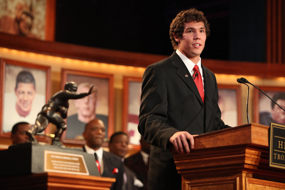 Oklahoma football player  Sam  Bradford, right, speaks after he won the Heisman Trophy during a ceremony Saturday, Dec. 13, 1008 in New York. (AP Photo/Kelly Kline, Pool)