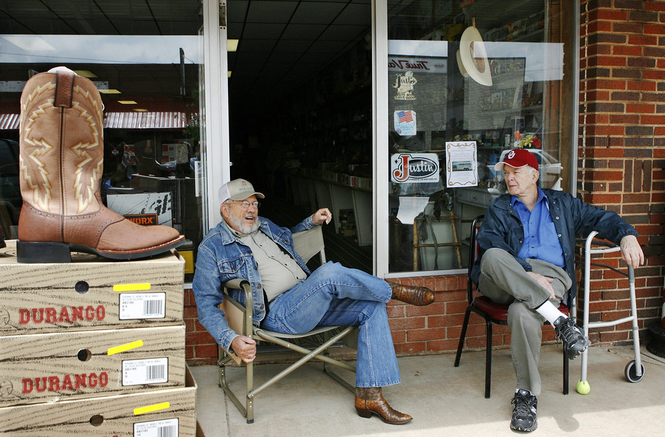 Photo - Dale Scott, left, and Howard Zwirtz enjoy the afternoon while sitting in front of Scott's dry goods store on Main Street in Hinton. They gave their reaction  to court decision involving the Hinton Economic Development Authority.  Photo taken Thursday,  April 30, 2009.    Photo by JIM BECKEL, THE OKLAHOMAN