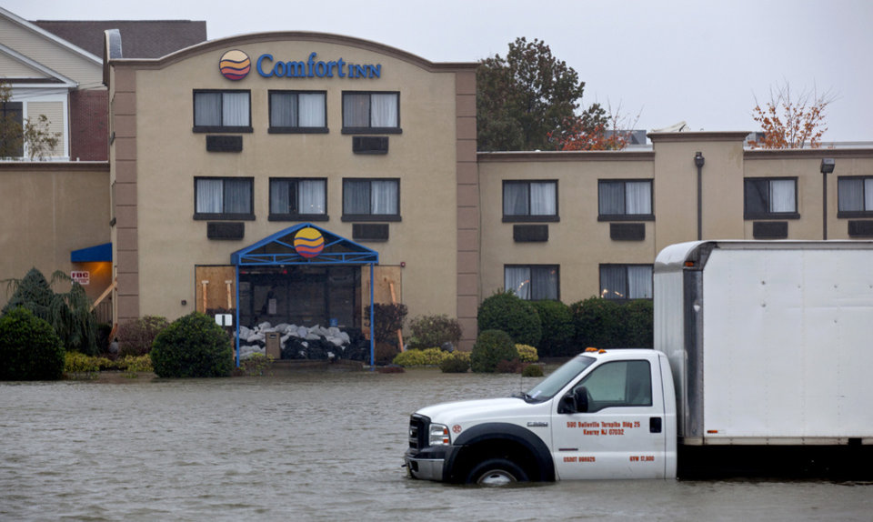Water from the Hudson River surrounds a hotel in Edgewater, N.J., Monday, Oct. 29, 2012 as Hurricane Sandy lashes the East Coast. Hurricane Sandy continued on its path Monday, as the storm forced the shutdown of mass transit, schools and financial markets, sending coastal residents fleeing, and threatening a dangerous mix of high winds and soaking rain. (AP Photo/Craig Ruttle) ORG XMIT: NJCR111