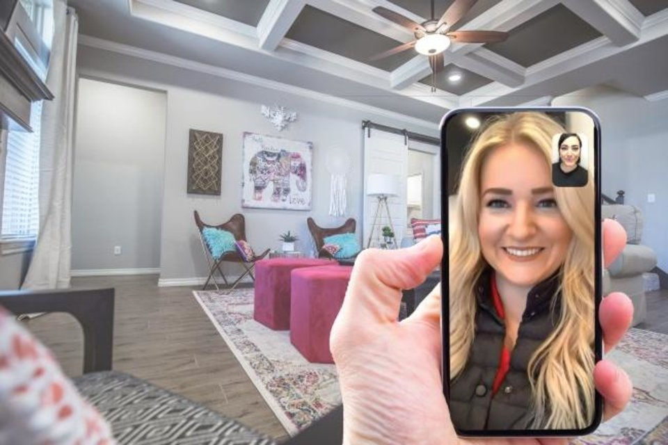 Photo -  Haley Reaves, community sales manager for Homes by Taber in The Grove neighborhood, is on a call with Sierra Reppert, a Taber homeowner and Taber marketing assistant. [PHOTO PROVIDED]