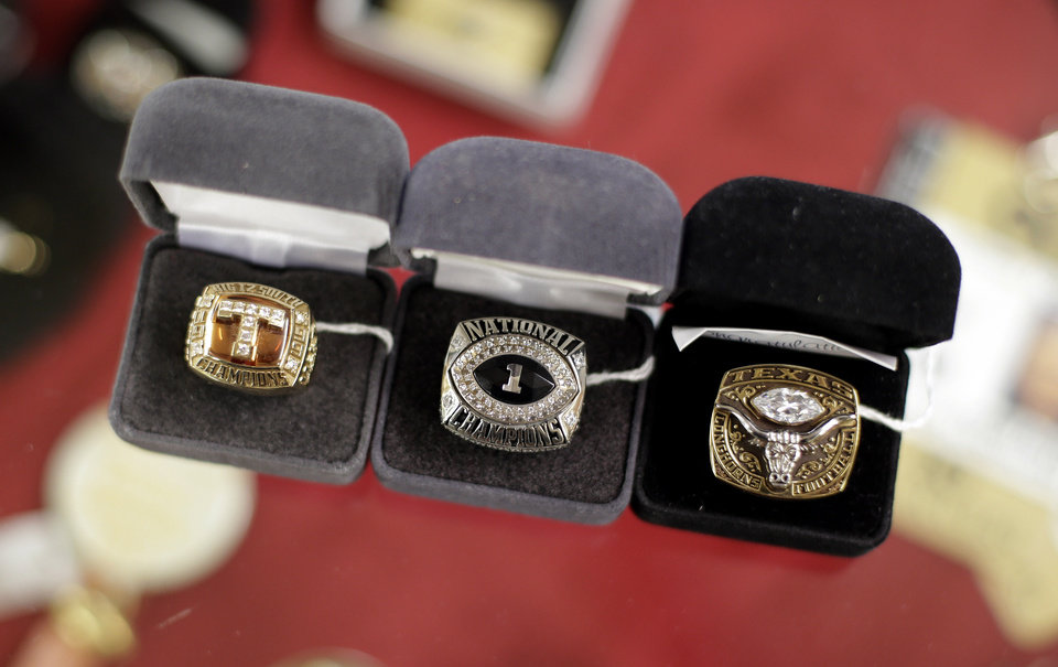 Photo -   Championship rings, part of Former Texas football coach Darrell Royal's Longhorn memorabilia to be auctioned for Alzheimer's research, are displayed at an auction house, Tuesday, Oct. 30, 2012, in Austin, Texas. The rings were presented to Royal in his retirement. (AP Photo/Eric Gay)