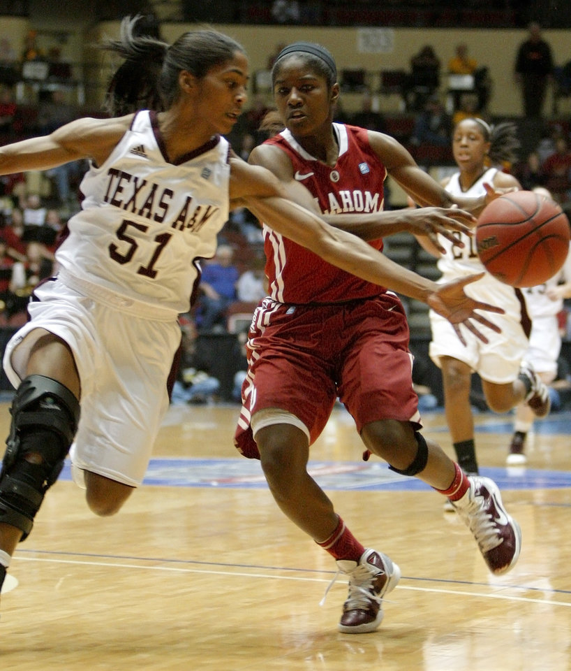 Texas A&M's Sydney Colson (51) steals the ball from OU's Aaryn Ellenberg (3) during the women's college basketball Big 12 Championship tournament game between the University of Oklahoma and Texas A&M in Kansas City, Mo., Friday, March 11, 2011.  Photo by Bryan Terry, The Oklahoman