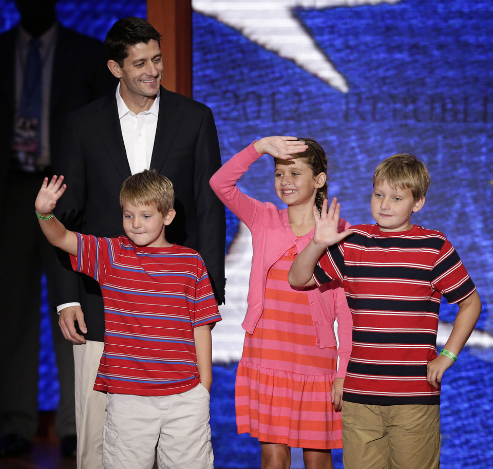 Photo -   Republican vice presidential nominee, Rep. Paul Ryan of Wisconsin walks across the stage with sons Sam, left, Charlie, right, and daughter Liza during a podium sound check at the Republican National Convention in Tampa, Fla., on Wednesday, Aug. 29, 2012. (AP Photo/J. Scott Applewhite)