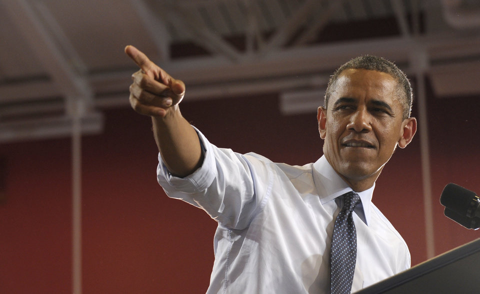 President Barack Obama speaks at the University of Central Missouri in  Warrensburg, Mo., Wednesday, July 24, 2013. Obama hit the road to deliver remarks in Illinois and Missouri kicking off a series of speeches that lay out his vision for rebuilding the economy. (AP Photo/Susan Walsh)