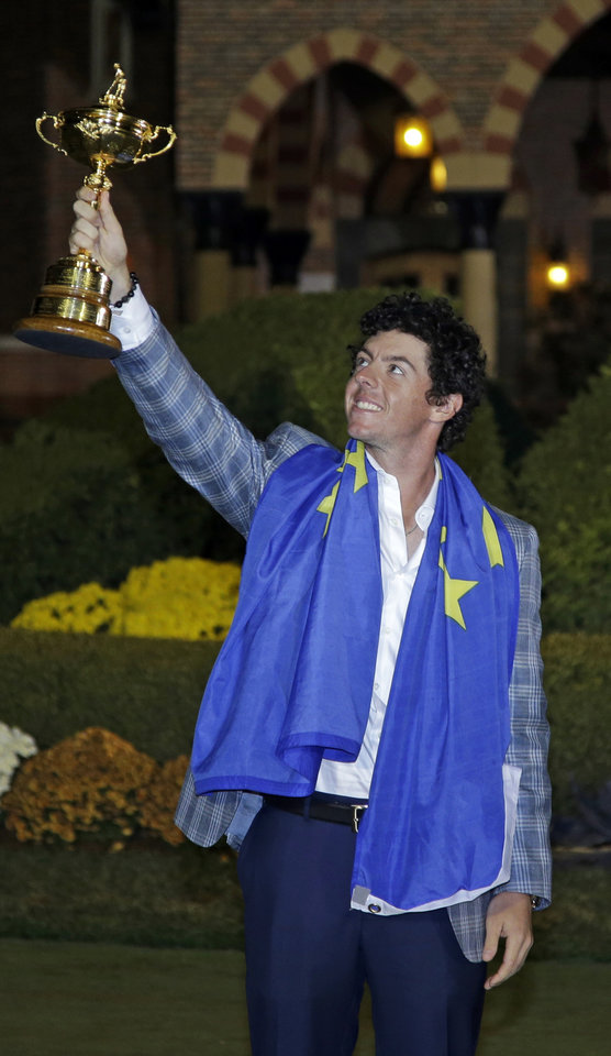 Europe's Rory McIlroy holds up the trophy after winning the Ryder Cup PGA golf tournament Sunday, Sept. 30, 2012, at the Medinah Country Club in Medinah, Ill. (AP Photo/Chris Carlson)  ORG XMIT: PGA291