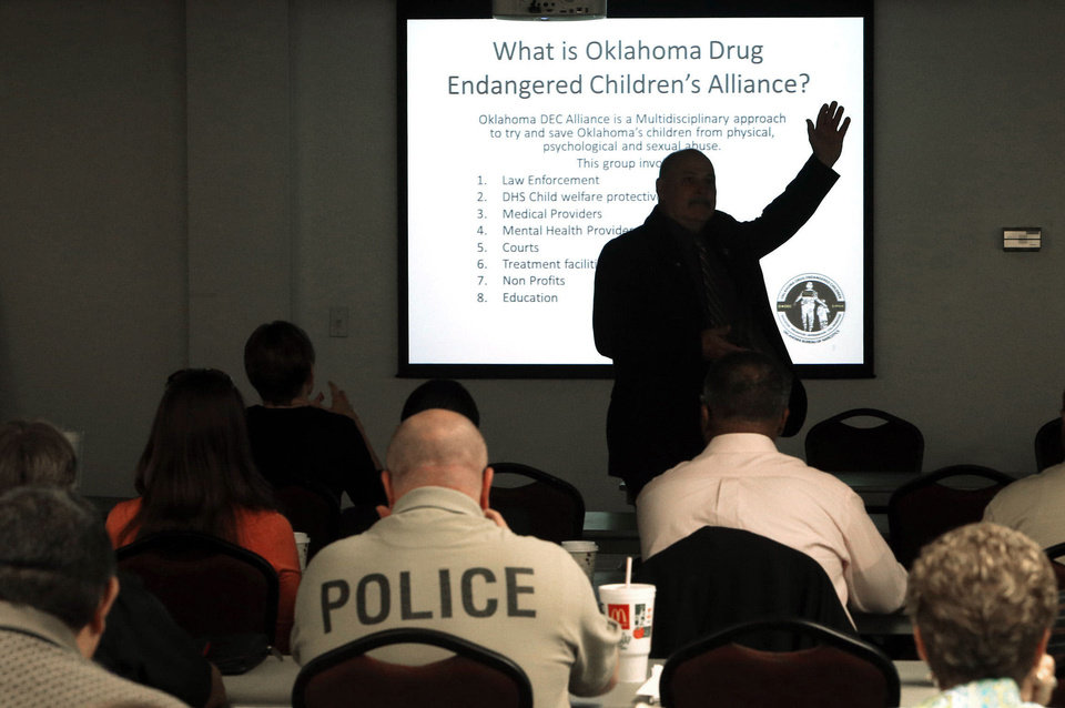 Photo - Dub Turner trains law enforcement, child welfare workers and prosecutors on Thursday, Aug. 15, 2013 in Norman, Okla. about what to do when children are found in drug homes.  Photo by Steve Sisney, The Oklahoman