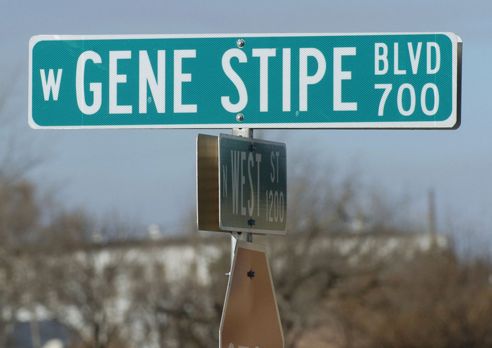 Photo - McAlester, Oklahoma, Tuesday, 12/27/05.     GENE STIPE BOULEVARD: McAlester City Council voted to change the name of Stipe Boulevard back to Electric Avenue.  Street sign with the prison in the background.   Staff photo by David McDaniel.