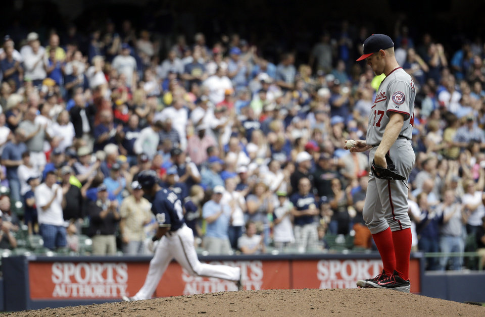 Photo - Washington Nationals starting pitcher Stephen Strasburg looks down at the ball after giving up a home run to Milwaukee Brewers' Khris Davis during the fourth inning of a baseball game Wednesday, June 25, 2014, in Milwaukee. (AP Photo/Morry Gash)