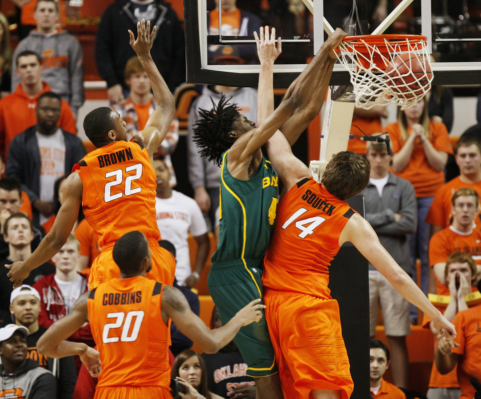 Photo - Baylor's Anthony Jones (41) dunks the ball over OSU's Marek Soucek (14) near Markel Brown (22) and Michael Cobbins (20) in the second half of a men's college basketball game between the Oklahoma State University Cowboys and the Baylor University Bears at Gallagher-Iba Arena in Stillwater, Okla., Saturday, Feb. 4, 2012. Baylor beat OSU, 64-60. Photo by Nate Billings, The Oklahoman