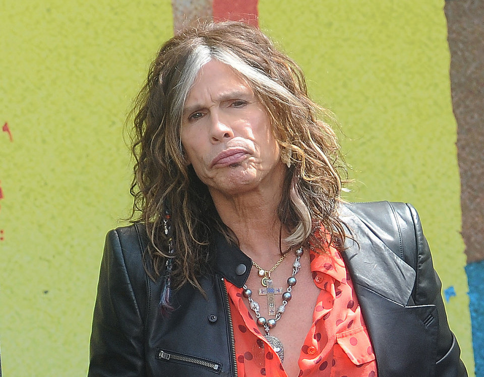 Photo -   FILE - This March 28, 2012 file photo shows Steven Tyler speaking at the Aerosmith news conference announcing the 2012 Global Warming Tour in Los Angeles. Tyler announced Thursday, July 12, 2012 that he will not be returning as a judge on the singing competition series