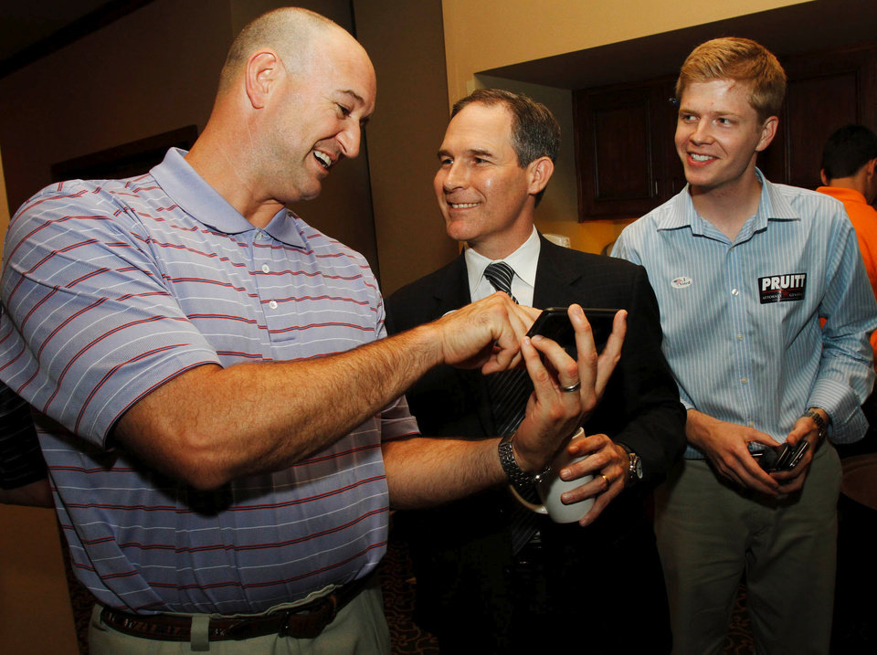 Photo - Republican candidate for Attorney General Scott Pruitt (middle) jokes with colleague Ken Wagner (left) and his campaign manager Tyler Laughlin during his watch party at the Cedar Ridge Country Club in Tulsa, Okla., on July 27,2010. JAMES GIBBARD/Tulsa World