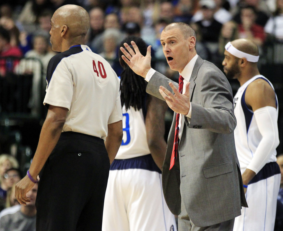 Dallas Mavericks head coach Rick Carlisle, right, protests a call to referee Leon Wood during the fourth quarter of an NBA basketball game against the Houston Rockets, Wednesday, Jan. 16, 2013, in Dallas. The Mavericks won 105-100. (AP Photo/John F. Rhodes)