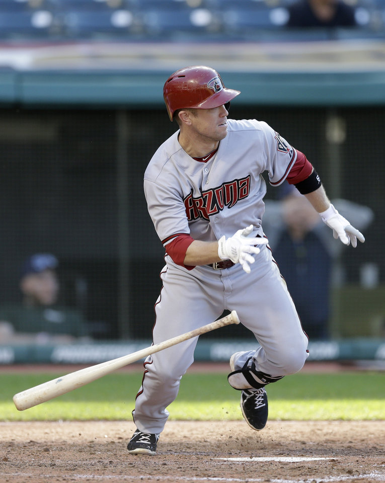 Photo - Arizona Diamondbacks' Aaron Hill runs out a ground ball hit off Cleveland Indians starting pitcher Trevor Bauer in the seventh inning of the first baseball game of a doubleheader, Wednesday, Aug. 13, 2014, in Cleveland. Hill was out on the play. Mark Trumbo scored on the play. (AP Photo/Tony Dejak)