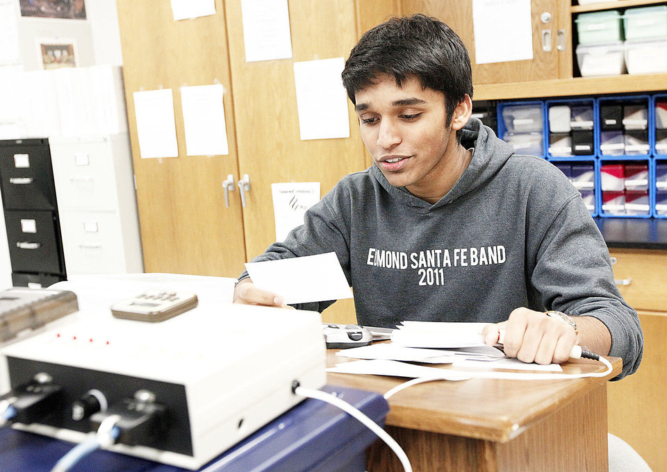 Science bowl team member Steven Kappen reads practice questions.
