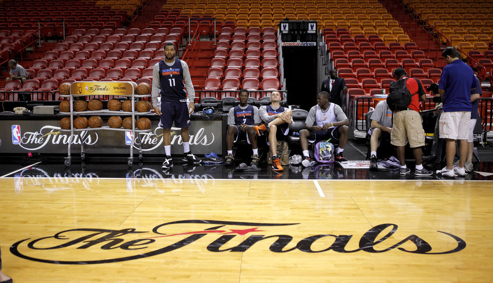 Oklahoma City\'s Lazar Hayward, left, Royal Ivey, Cole Aldrich, and Reggie Jackson wait for the start of a practice before Game 4 of the NBA Finals between the Oklahoma City Thunder and the Miami Heat at American Airlines Arena, Monday, June 18, 2012. Photo by Bryan Terry, The Oklahoman