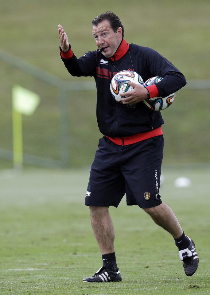 Photo - Belgium's head coach Marc Wilmots blows his whistle a training session of Belgium in Mogi Das Cruzes, Brazil, Thursday, June 19, 2014. Belgium play in group H of the 2014 soccer World Cup. (AP Photo/Andrew Medichini)