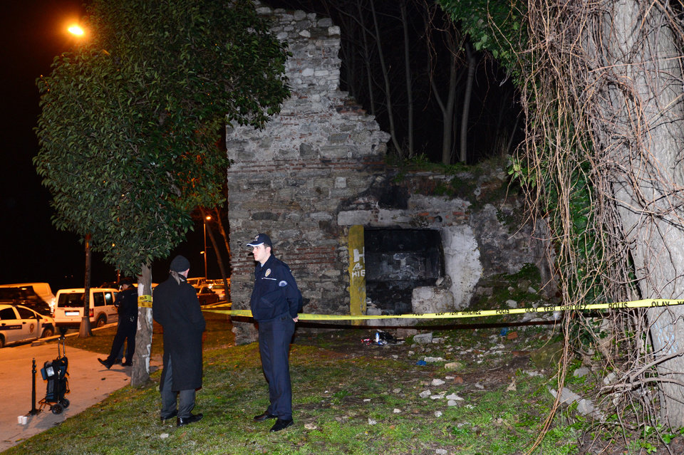 Photo - Police forensics search for missing New York City woman Sarai Sierra near the remnants of some ancient city walls in low-income district of Sarayburnu in Istanbul, Turkey, late Saturday, Feb. 2, 2013. Turkey's state-run news agency said that she has been found dead in Istanbul and police have detained nine people in connection with the case. Sierra, a 33-year-old mother of two, went missing while vacationing alone in Istanbul. Her body was discovered late Saturday amid the city walls.(AP Photo)